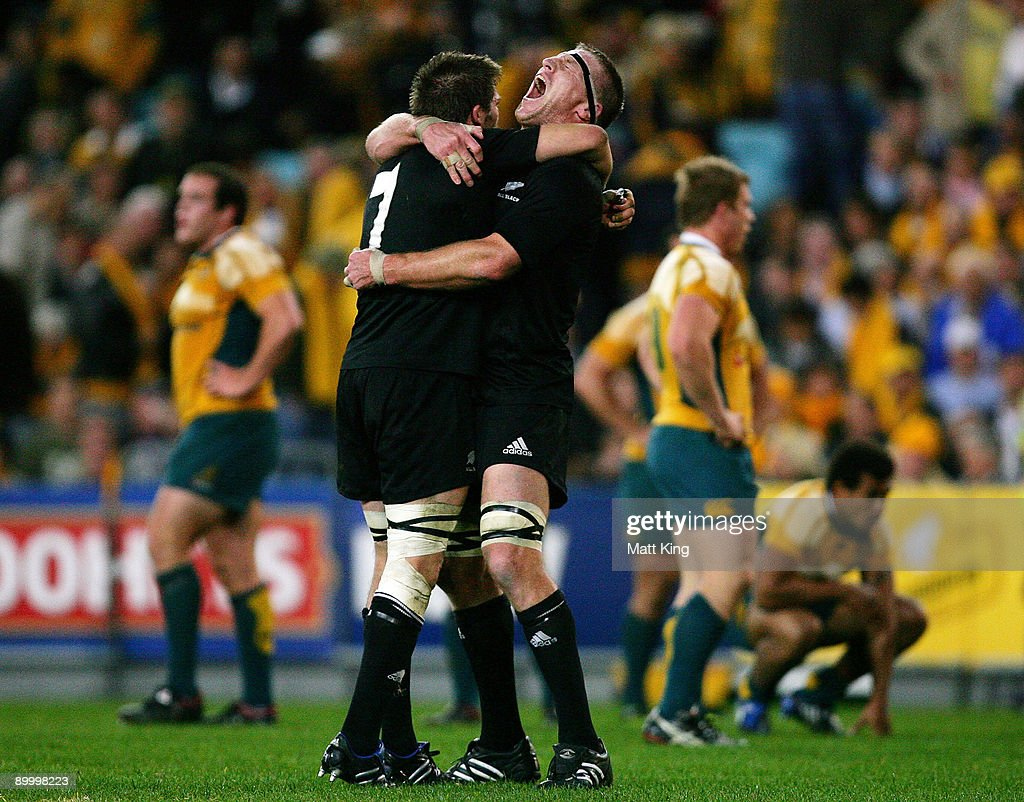 Richie McCaw and Brad Thorn of the All Blacks celebrate victory after the 2009 Tri Nations series Bledisloe Cup match between the Australian Wallabies and the New Zealand All Blacks at ANZ Stadium on August 22, 2009 in Sydney, Australia.
