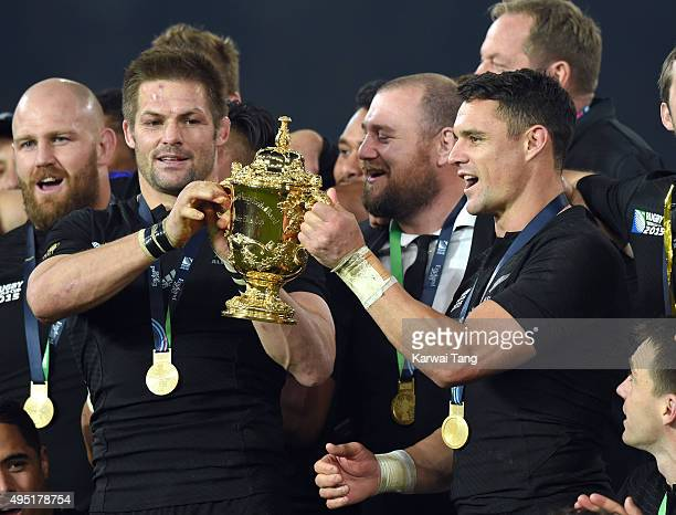 Richie McCaw and Dan Carter lift the Webb Ellis Cup after New Zealand defeated Australia in the Rugby World Cup Final at Twickenham Stadium on...