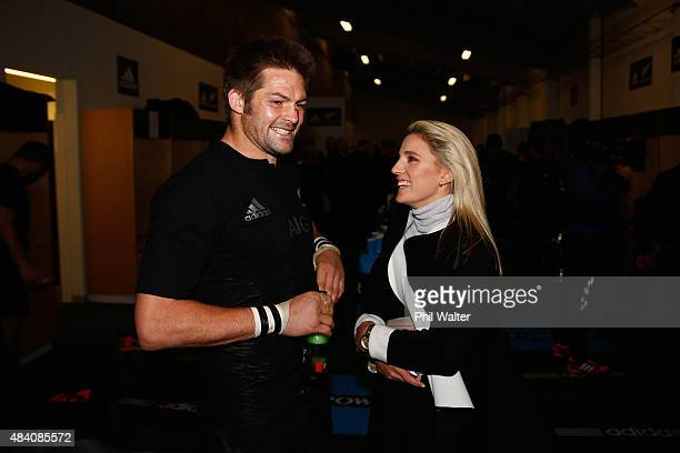 Richie McCaw and Gemma Flynn chat in the dressing room following The Rugby Championship Bledisloe Cup match between the New Zealand All Blacks and...
