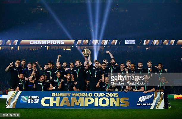 Richie McCaw and Kieran Read of the New Zealand All Blacks lift the Webb Ellis Cup following the victory against Australia in the 2015 Rugby World...