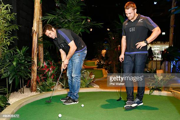 Richie McCaw and Sam Cane of the All Blacks play Mini Golf courtesy of sponsor AIG at Treetop Adventure Golf on October 1 2015 in Cardiff United...