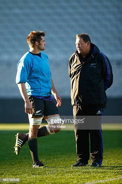 Richie McCaw and Steve Hansen chat during a New Zealand All Blacks training session at Eden Park on August 13 2015 in Auckland New Zealand