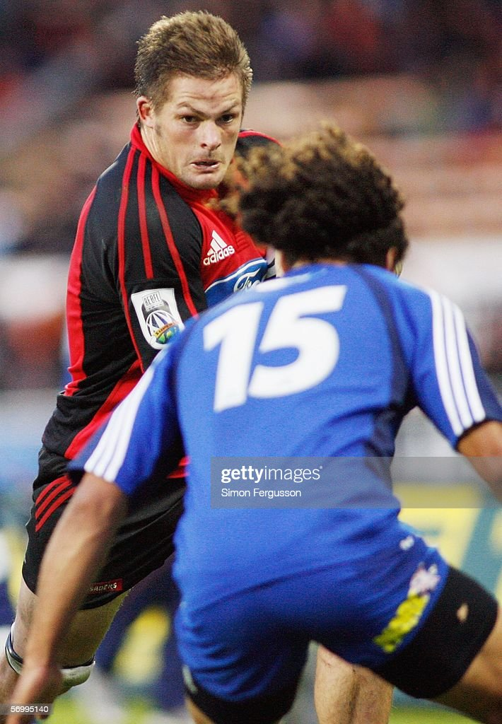 Richie McCaw Captain of the Crusaders prepares to break past Blues number 15 Isa Nacewa during the round four Super 14 match between the Crusaders...