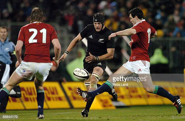 Richie McCaw chips the ball between Will Greenwood and Stephen Jones during the All Blacks V British and Irish Lions rugby test at Jade Stadium...