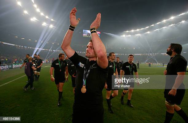 Richie McCaw of New Zealand acknowledges the crowd as he celebrates victory following the 2015 Rugby World Cup Final match between New Zealand and...