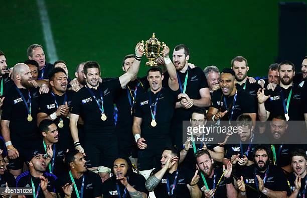 Richie McCaw of New Zealand and Dan Carter of New Zealand hold aloft the Webb Ellis Cup during the 2015 Rugby World Cup Final match between New...