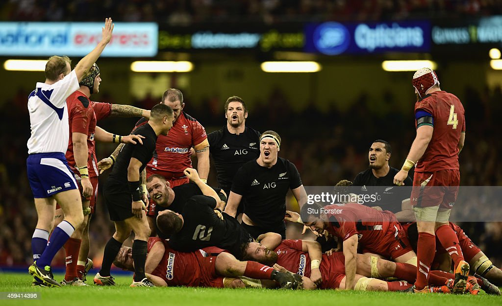 Richie McCaw of New Zealand and team mates reacts after a decision by referee Wayne Barnes during the International match between Wales and New Zealand All Blacks at Millennium Stadium on November 22, 2014 in Cardiff, Wales.