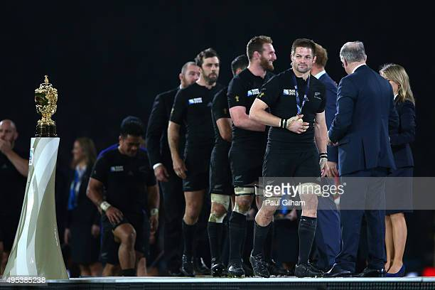 Richie McCaw of New Zealand collects his winners medal during the 2015 Rugby World Cup Final match between New Zealand and Australia at Twickenham...