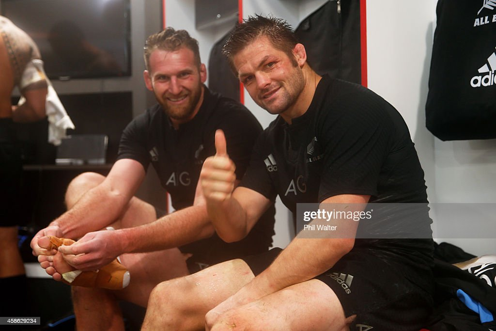 Richie McCaw of New Zealand gives the thumbs up with Kieran Read of New Zealand in the changing room after the QBE International match between...