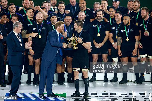 Richie McCaw of New Zealand recieves the trophy from Prince Harry after the 2015 Rugby World Cup Final match between New Zealand and Australia at...