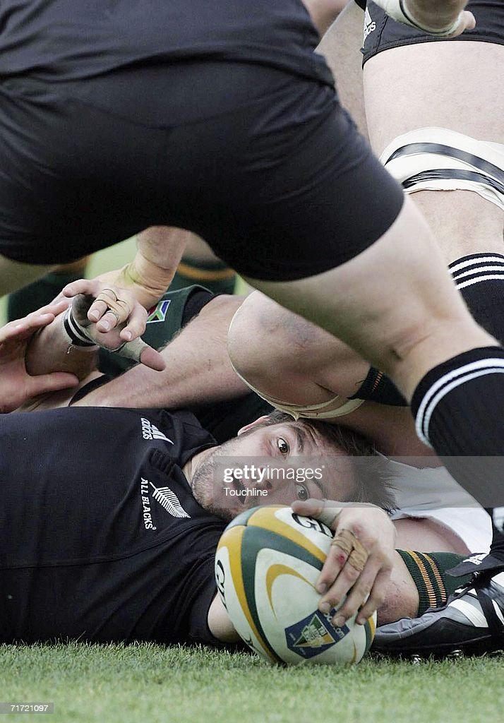 Richie McCaw of New Zealand secures the ruck ball during the TriNations rugby international on Audust 26 between the New Zealand All Blacks and the...