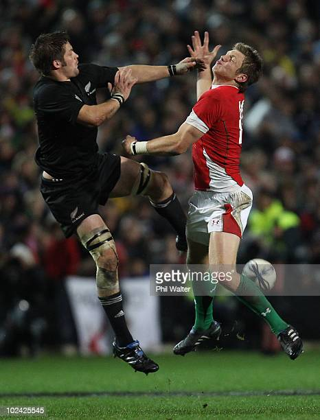 Richie McCaw of the All Blacks and Dan Biggar of Wales compete for the high ball during the rugby test match between the New Zealand All Blacks and...