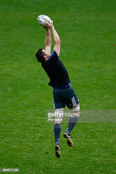 Richie McCaw of the All Blacks collects the high ball during a New Zealand All Blacks Captain's Run at Pennyhill Park on October 30 2015 in London...
