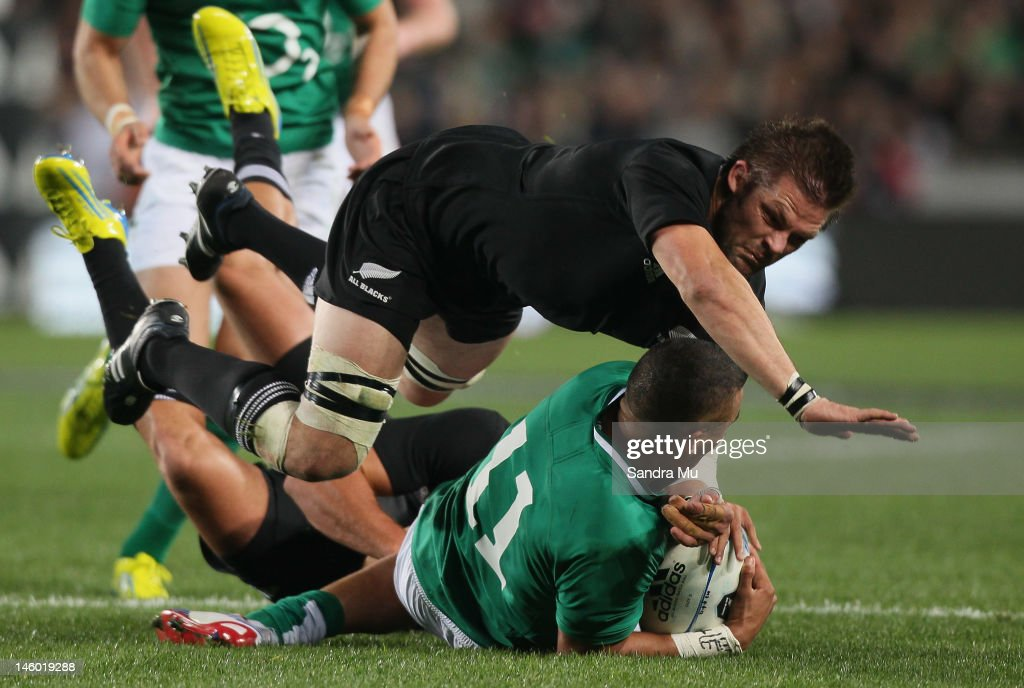 <a gi-track='captionPersonalityLinkClicked' href=/galleries/search?phrase=Richie+McCaw&family=editorial&specificpeople=165235 ng-click='$event.stopPropagation()'>Richie McCaw</a> of the All Blacks dives over Simon Rebo of Ireland during the International Test Match between the New Zealand All Blacks and Ireland at Eden Park on June 9, 2012 in Auckland, New Zealand.