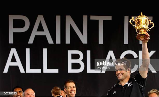 Richie McCaw of the All Blacks holds up the Webb Ellis Cup during the New Zealand All Blacks 2011 IRB Rugby World Cup celebration parade on October...