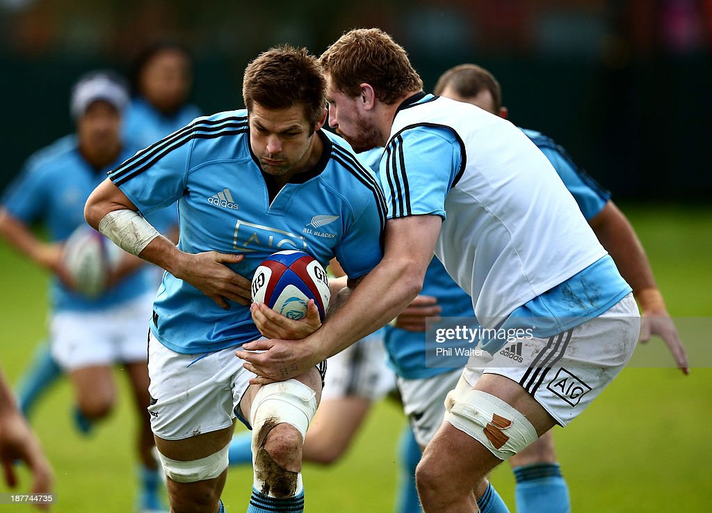 <a gi-track='captionPersonalityLinkClicked' href=/galleries/search?phrase=Richie+McCaw&family=editorial&specificpeople=165235 ng-click='$event.stopPropagation()'>Richie McCaw</a> of the All Blacks is tackled by Dominic Bird during a New Zealand All Blacks training session at Latymers Upper School on November 12, 2013 in London, England.