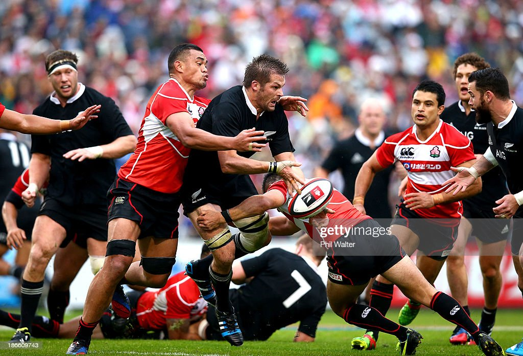 <a gi-track='captionPersonalityLinkClicked' href=/galleries/search?phrase=Richie+McCaw&family=editorial&specificpeople=165235 ng-click='$event.stopPropagation()'>Richie McCaw</a> of the All Blacks is tackled by Hendrick Tui of Japan during the International Rugby Test Match between Japan and the New Zealand All Blacks at Prince Chichibu Memorial Rugby Stadium on November 2, 2013 in Tokyo, Japan.