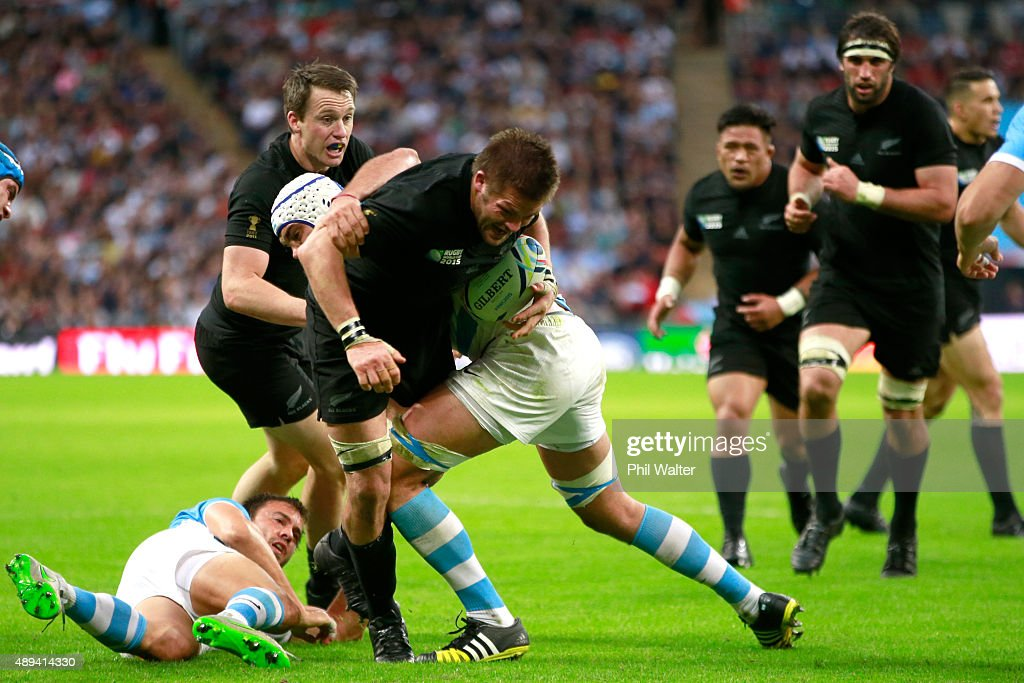 Richie McCaw of the All Blacks is tackled during the 2015 Rugby World Cup Pool C match between New Zealand and Argentina at Wembley Stadium on September 20, 2015 in London, United Kingdom.