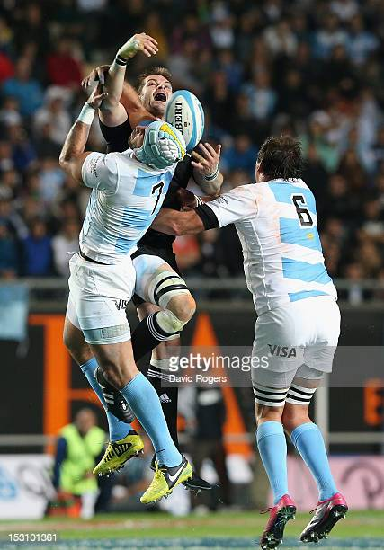 Richie McCaw of the All Blacks out jumps Juan Manuel Leguizamon and Julio Farias Cabello during the Rugby Championship match between Argentina and...