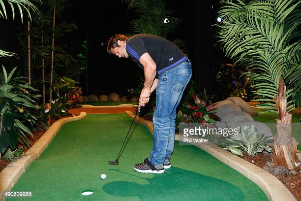 Richie McCaw of the All Blacks plays Mini Golf courtesy of sponsor AIG at Treetop Adventure Golf on October 1 2015 in Cardiff United Kingdom