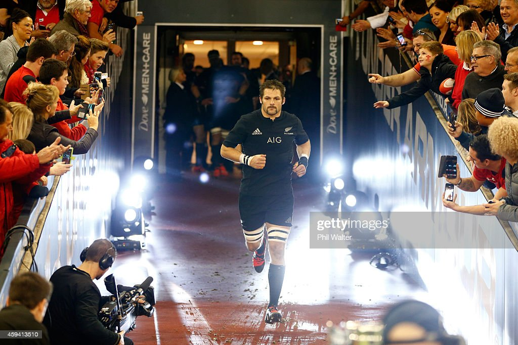 <a gi-track='captionPersonalityLinkClicked' href=/galleries/search?phrase=Richie+McCaw&family=editorial&specificpeople=165235 ng-click='$event.stopPropagation()'>Richie McCaw</a> of the All Blacks runs out onto the field for his 100th game as All Black captain during the Intenational match between Wales and the New Zealand All Blacks at the Millennium Stadium on November 22, 2014 in Cardiff, Wales.