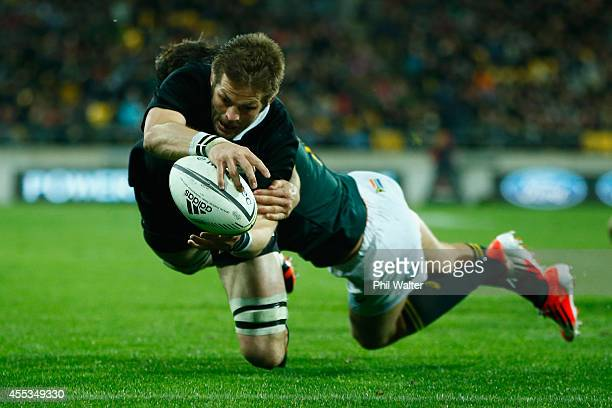 Richie McCaw of the All Blacks scores a try during The Rugby Championship match between the New Zealand All Blacks and the South Africa Springboks at...