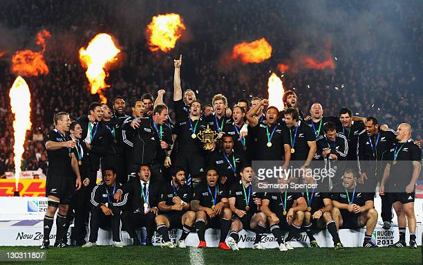 Richie McCaw of the All Blacks sings with team mates after lifting the Webb Ellis Cup after the 2011 IRB Rugby World Cup Final match between France...
