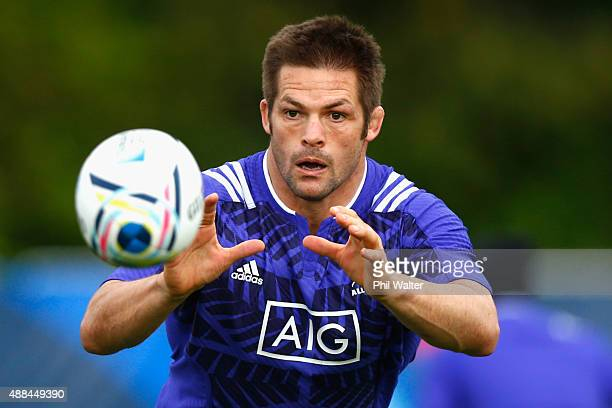 Richie McCaw of the All Blacks takes a pass during a New Zealand All Blacks training session at Lensbury on September 16 2015 in London United Kingdom