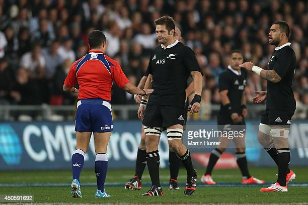 Richie McCaw of the All Blacks talks to referee Jaco Peyper during the International Test Match between the New Zealand All Blacks and England at...