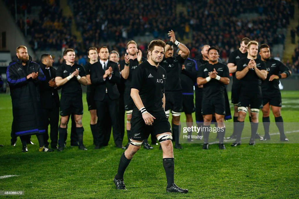Richie McCaw of the All Blacks walks up to be handed a commemorative jersey from coach Steve Hansen following The Rugby Championship, Bledisloe Cup match between the New Zealand All Blacks and the Australian Wallabies at Eden Park on August 15, 2015 in Auckland, New Zealand.