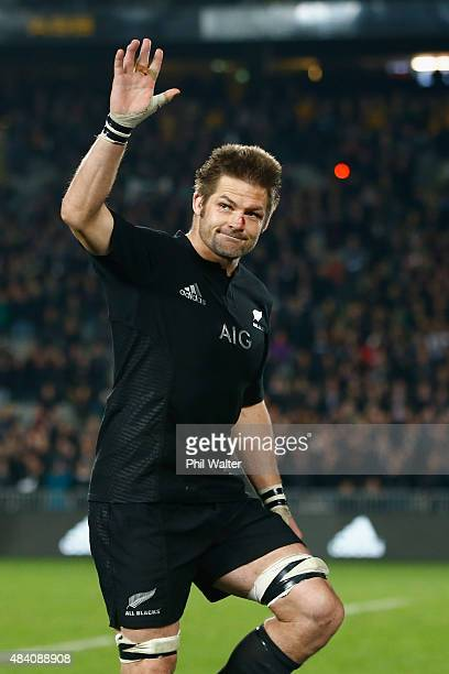Richie McCaw of the All Blacks walks up to be handed a commemorative jersey from coach Steve Hansen following The Rugby Championship Bledisloe Cup...