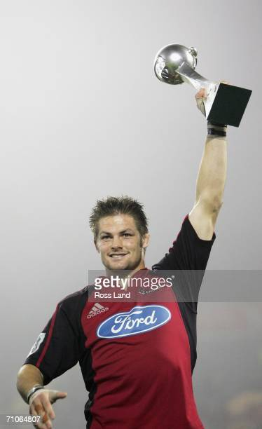 Richie McCaw of the Crusaders holds the trophy aloft following his teams win over the Hurricanes in the Super 14 final match between the Crusaders...