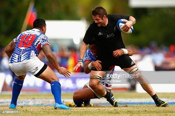 Richie McCaw of the New Zealand All Blacks is tackled during the International Test match between Samoa and the New Zealand All Blacks at Apia...
