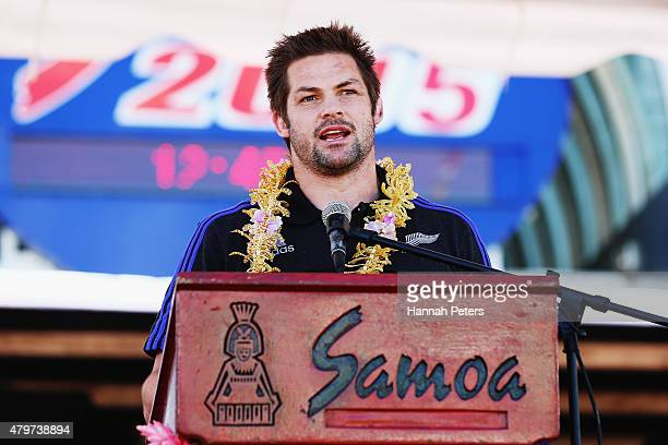 Richie McCaw of the New Zealand All Blacks speaks to fans following a parade through the main streets of Apia on July 7 2015 in Apia Samoa