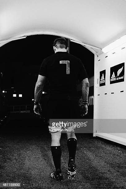 Richie McCaw of the New Zealand All Blacks walks down the tunnel after winning The New Zealand All Blacks passes the ball out during The Rugby...