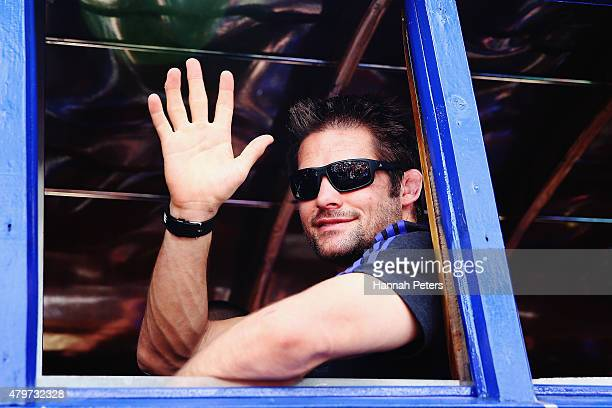 Richie McCaw of the New Zealand All Blacks waves to fans during a parade down the main street of Apia on July 7 2015 in Apia Samoa