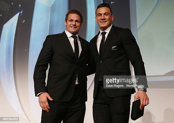 Richie McCaw presents teammate Sonny Bill Williams of New Zealand a replacement winners medal for the one that he gave to young fan Charlie Lines...