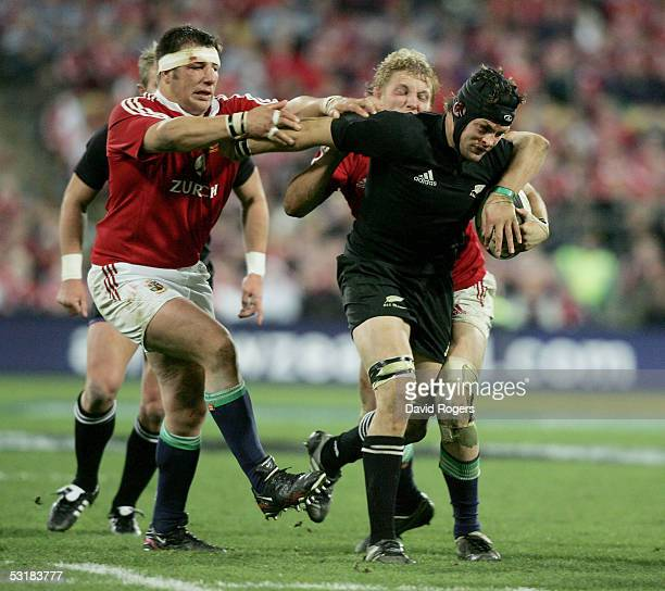 Richie McCaw the All Black flank forward is held by Julian White and Lewis Moody during the second test match between The New Zealand All Blacks and...