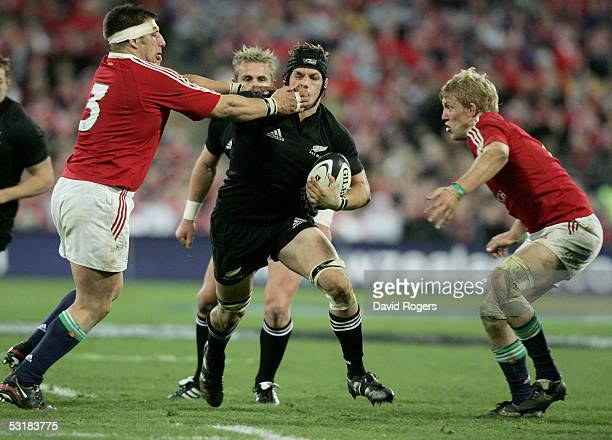 Richie McCaw the All Black flank forward is held by Julian White as Lewis Moody looks on during the second test match between The New Zealand All...