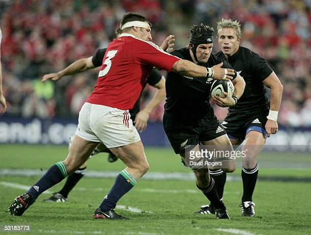 Richie McCaw the All Black flank forward is held by Julian White during the second test match between The New Zealand All Blacks and the British and...