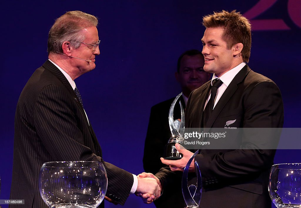 <a gi-track='captionPersonalityLinkClicked' href=/galleries/search?phrase=Richie+McCaw&family=editorial&specificpeople=165235 ng-click='$event.stopPropagation()'>Richie McCaw</a> (R) the captain of New Zealand receives the Player of The Year award from <a gi-track='captionPersonalityLinkClicked' href=/galleries/search?phrase=Bernard+Lapasset&family=editorial&specificpeople=769984 ng-click='$event.stopPropagation()'>Bernard Lapasset</a> the Chairman of Rugby World Cup Ltd during the IRB Rugby World Cup 2015 pool allocation draw at the Tate Modern on December 3, 2012 in London, England.