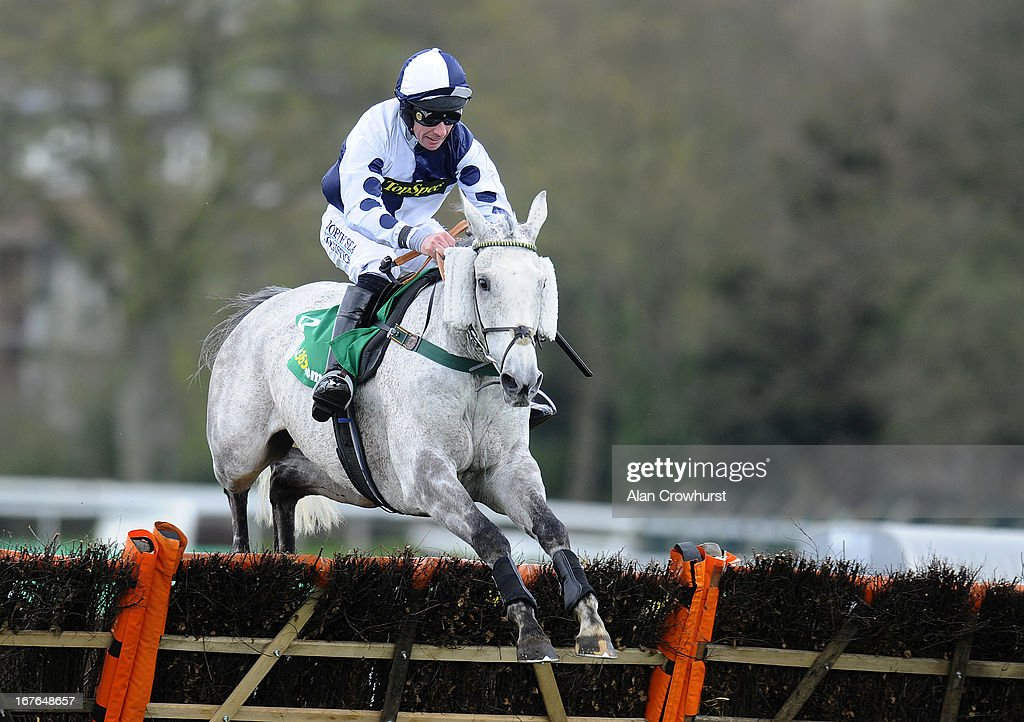 Richie McGrath riding Stopped Out clear the last to win The bet365 Handicap Hurdle Race at Sandown racecourse on April 27, 2013 in Esher, England.