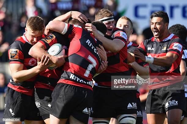 Richie Mounga of Canterbury and his teammates celebrate after George Bridge scores a try during the round four Mitre 10 Cup match between Canterbury...