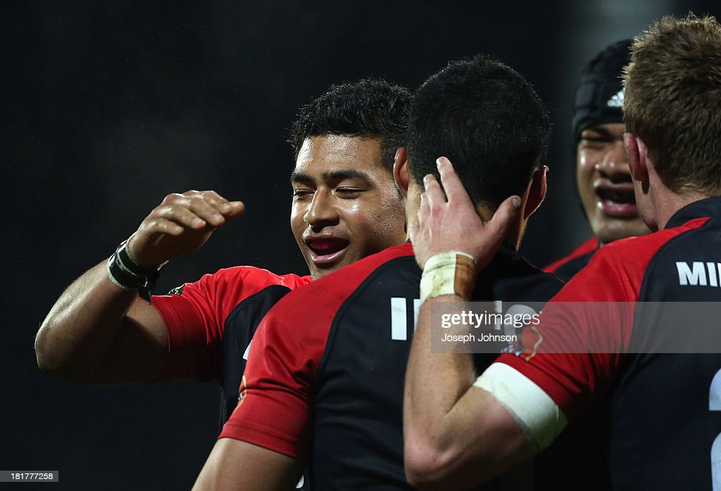 Richie Mo'unga of Canterbury congratulates Milford Keresoma during the round 7 ITM Cup match between Canterbury and Manawatu at AMI Stadium on September 25, 2013 in Christchurch, New Zealand.