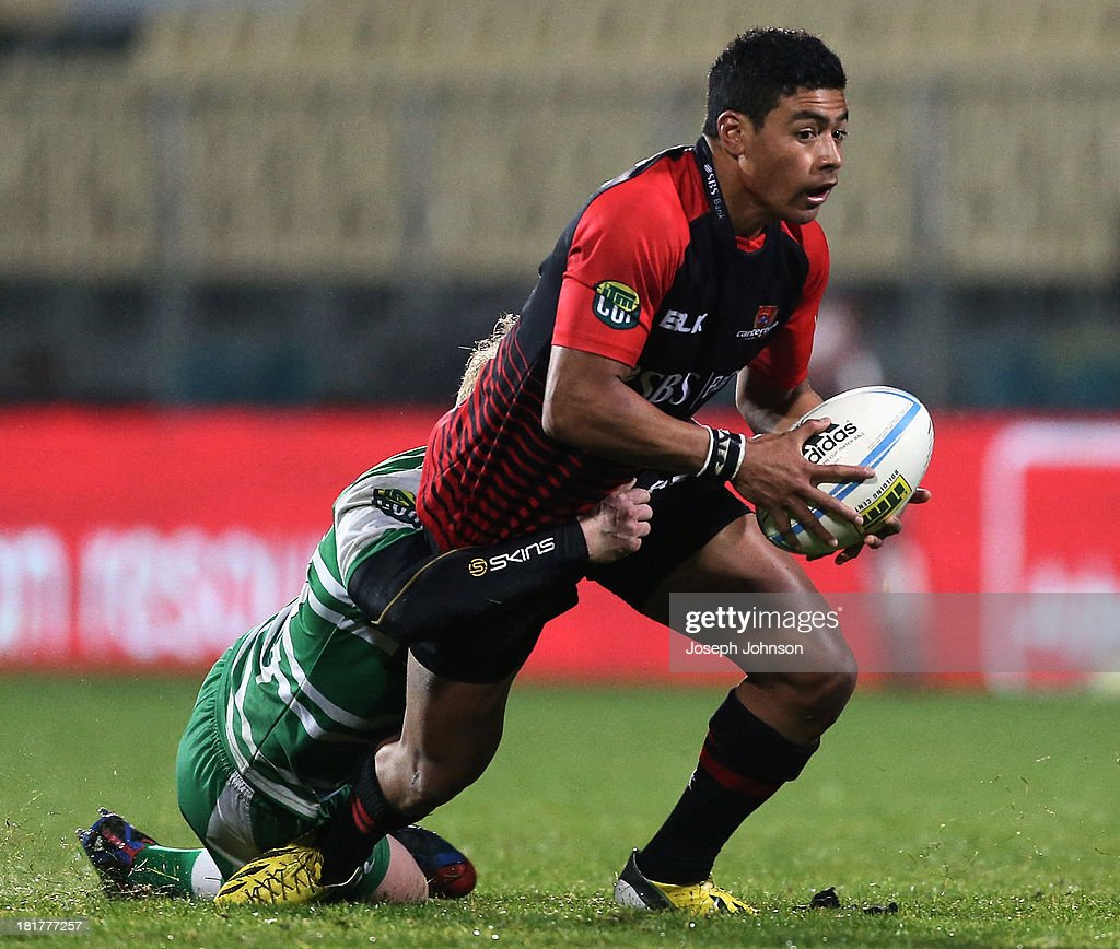 Richie Mo'unga of Canterbury in the tackle of Nate George during the round 7 ITM Cup match between Canterbury and Manawatu at AMI Stadium on September 25, 2013 in Christchurch, New Zealand.