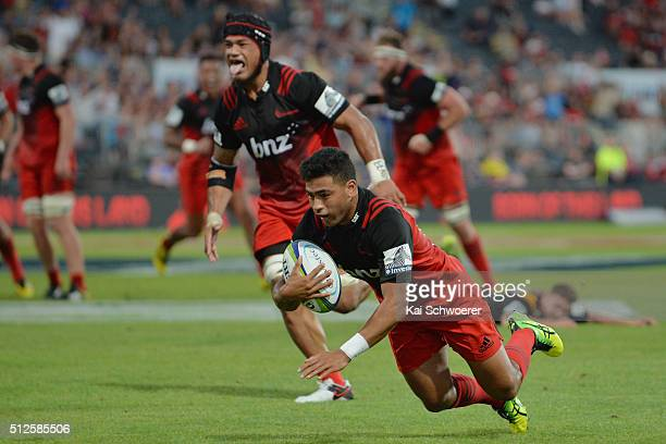 Richie Mounga of the Crusaders dives over to score a try during the round one Super Rugby match between the Crusaders and the Chiefs at AMI Stadium...