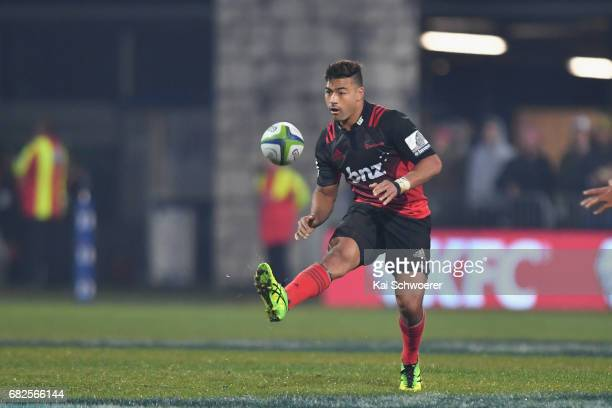 Richie Mo'unga of the Crusaders kicks the ball during the round 12 Super Rugby match between the Crusaders and the Hurricanes at AMI Stadium on May...