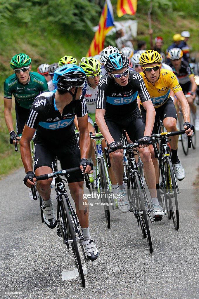 Richie Porte (L) of Australia riding for Sky Procycling leads the group on the climb of the Mur de Peguere ahead of teammates Christopher Froome (C) of Great Britain and <a gi-track='captionPersonalityLinkClicked' href=/galleries/search?phrase=Bradley+Wiggins&family=editorial&specificpeople=182490 ng-click='$event.stopPropagation()'>Bradley Wiggins</a> (R) of Great Britain in the race leader's yellow jersey during stage fourteen of the 2012 Tour de France from Limoux to Foix on July 15, 2012 in Boussenac, France.