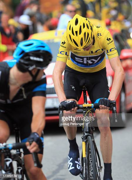 Richie Porte of Australia riding for Sky Procycling looks over his shoulder as his team leader Chris Froome of Great Britain riding for Sky...