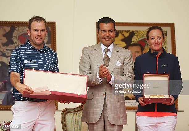 Richie Ramsay of Scotland and Gwladys Nocera of France pose with HRH Prince Moulay Rachid of Morocco and their winner's trophies after the final...